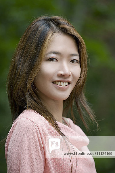 Close up of smiling Asian woman