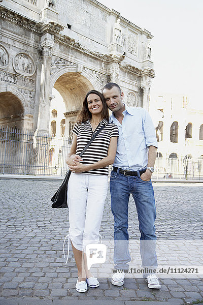 Tourist couple hugging near ruins