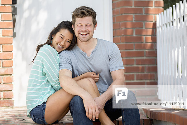 Couple smiling together outdoors