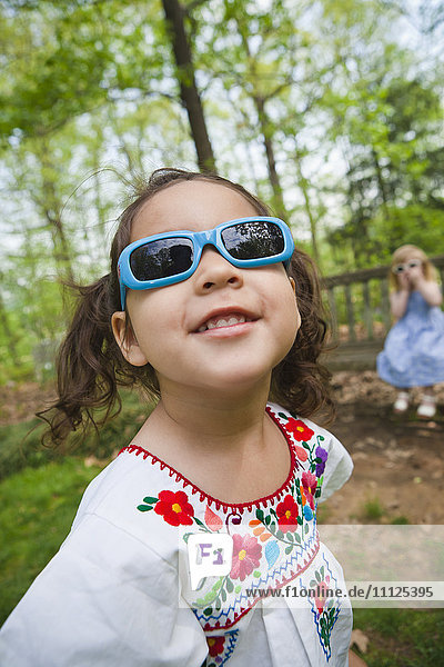 Girl in sunglasses standing outdoors