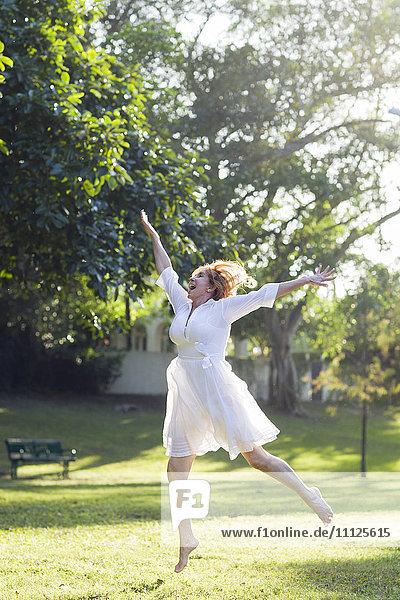 Hispanic woman dancing outdoors