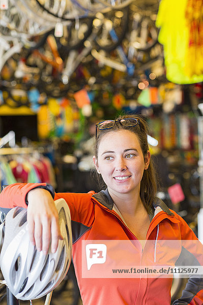 Caucasian woman standing in bicycle shop