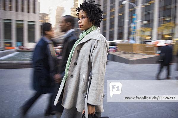 African American woman on urban sidewalk