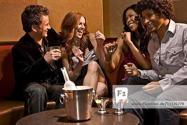 Friends drinking together in nightclub