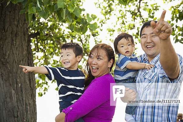Japanese family playing in park