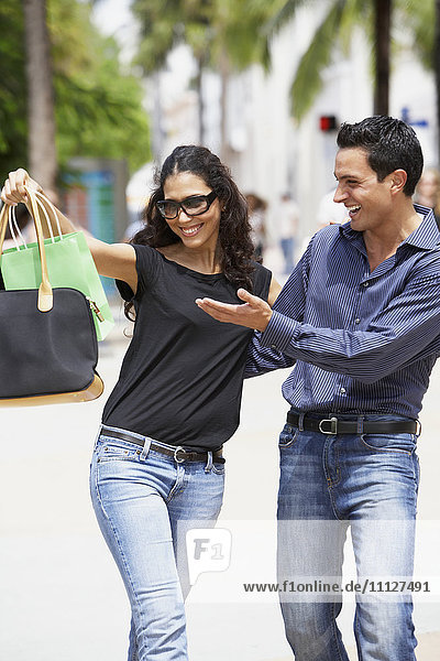 Couple looking at shopping bag