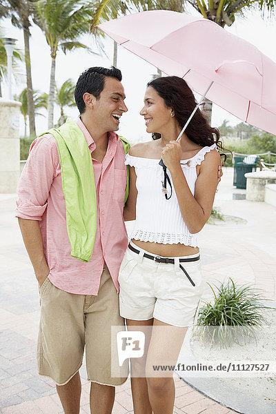 Couple walking with umbrella