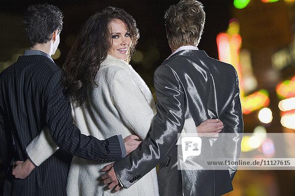 Multi-ethnic men and woman in formal attire walking