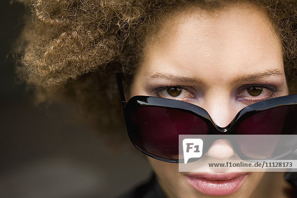 Close up of mixed race woman wearing sunglasses