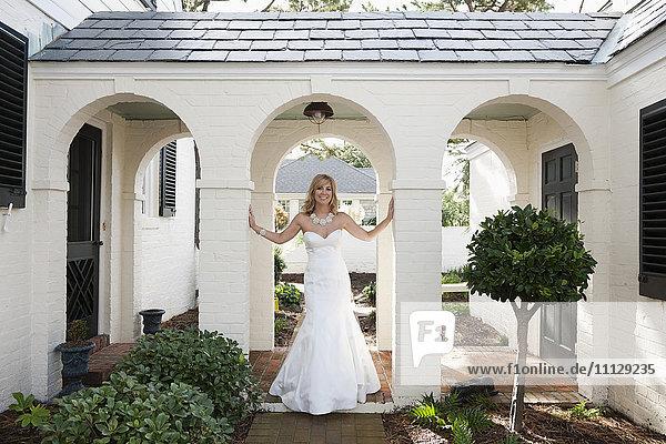 Glamorous Caucasian bride in wedding dress