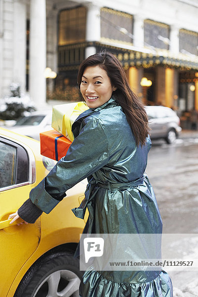 Korean woman with gifts taking taxi
