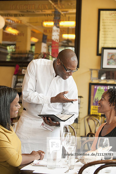 African American friends having lunch in restaurant