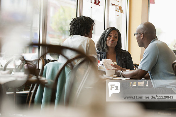 African American co-workers working in restaurant