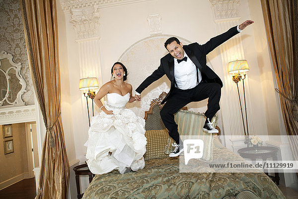 Egyptian bride jumping on bed