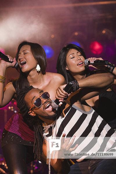 Musical group singing onstage