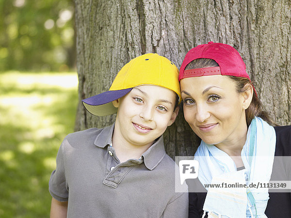 Mother and son wearing baseball caps