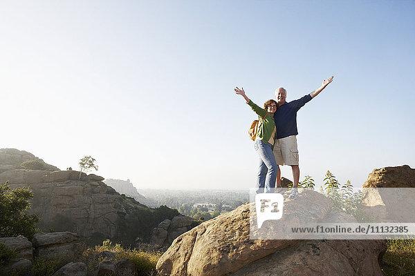 Caucasian couple hiking in remote area