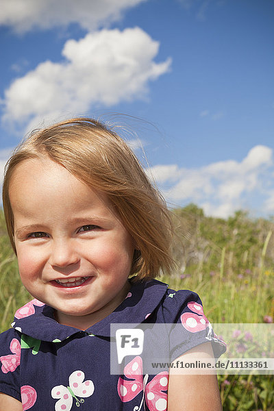 Smiling mixed race girl standing outdoors