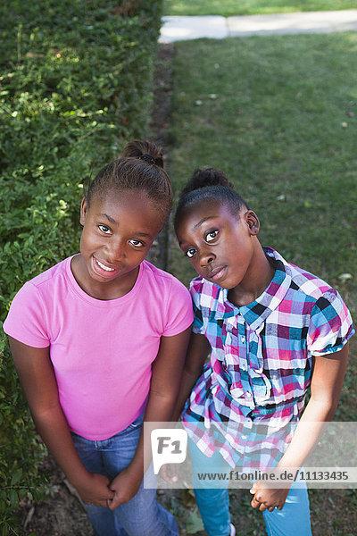 Black girls standing together