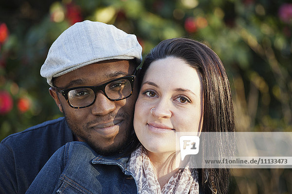 Smiling couple standing outdoors