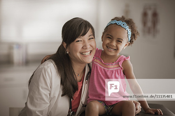 Doctor and girl smiling in doctor's office