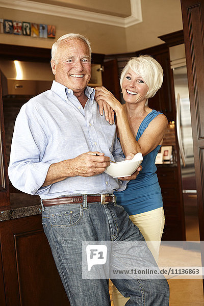 Caucasian couple standing in kitchen
