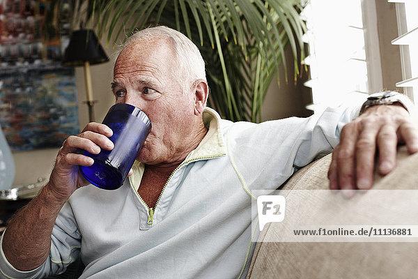 Caucasian man drinking water