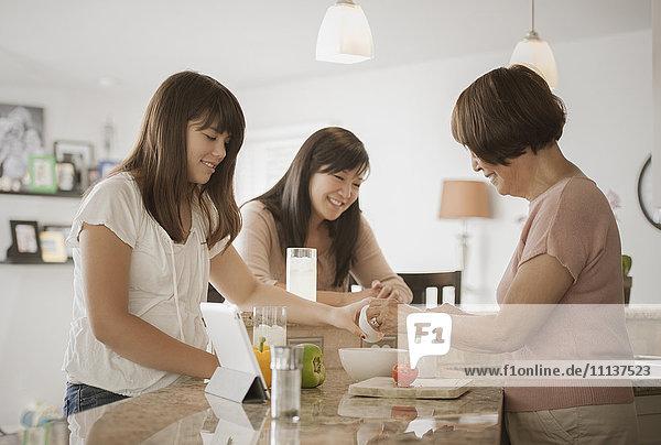 Grandmother  mother and daughter preparing food