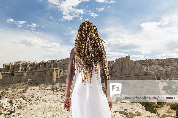 African American woman examining rock formations  Santa Fe  New Mexico  United States