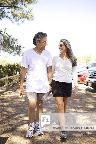 Older Caucasian couple walking outdoors