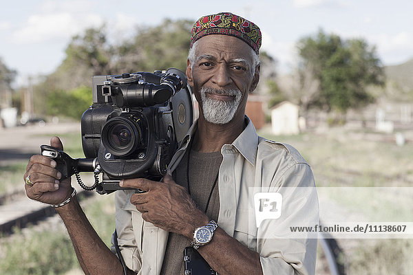 African American man using film camera