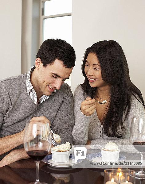Couple eating dessert together