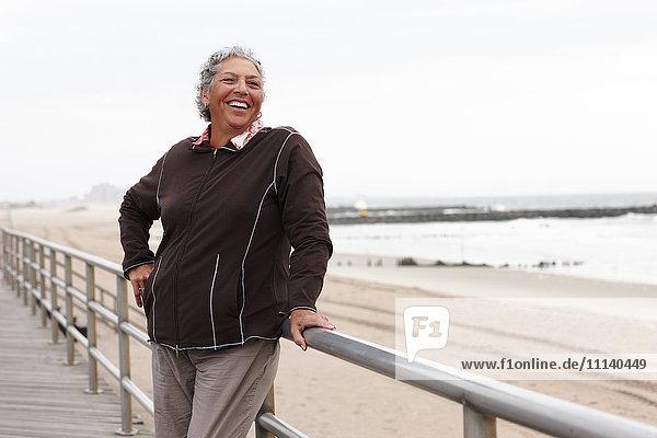 Smiling woman enjoying boardwalk