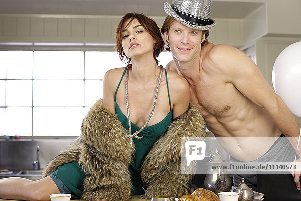 Couple in kitchen during party