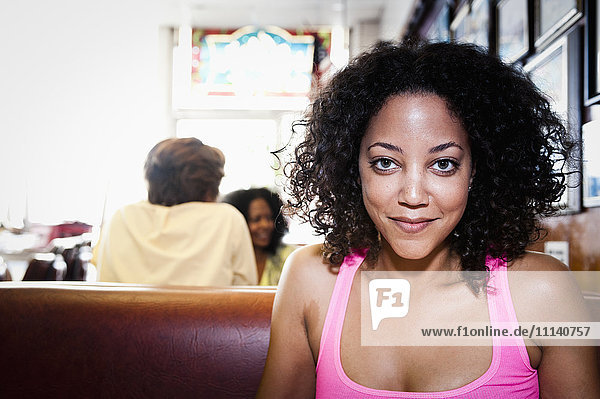 Smiling African American woman in diner