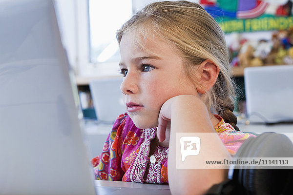 Caucasian girl using computer