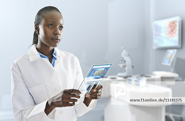 African American doctor using digital tablet in laboratory