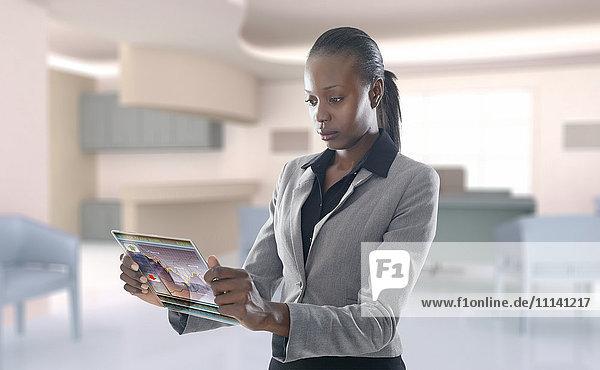 African American businesswoman using digital display