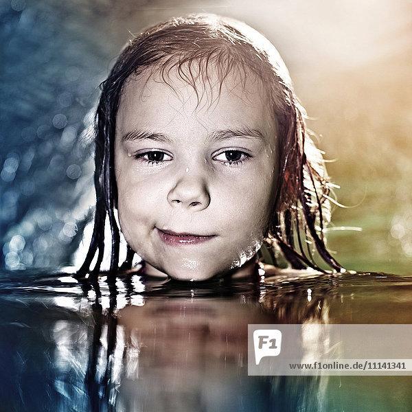 Caucasian girl swimming in water