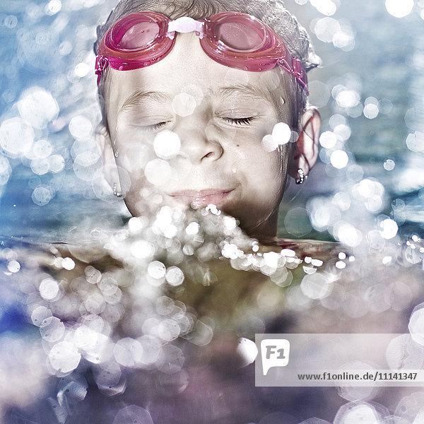 Caucasian girl swimming in water Caucasian girl swimming in water