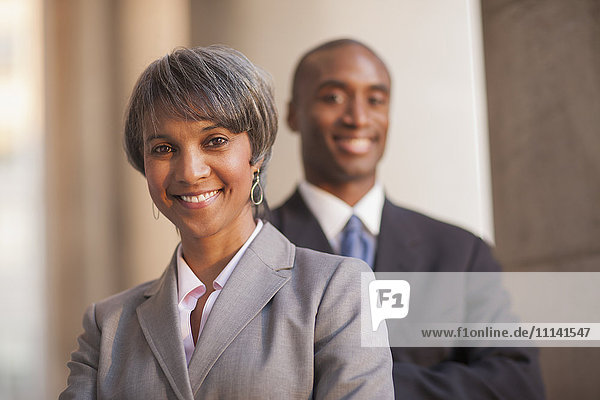 Black business people smiling