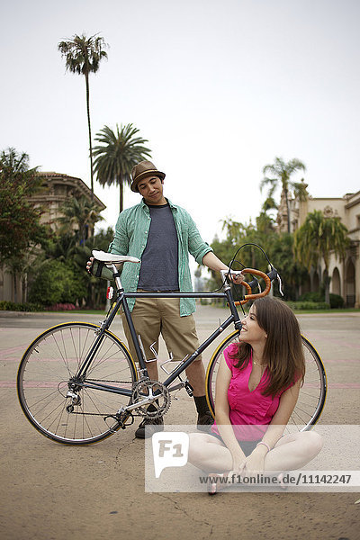 Couple together outdoors with bicycle