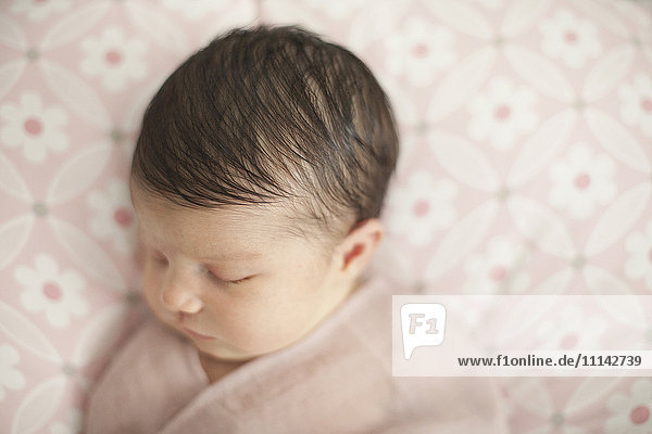 Caucasian baby girl swaddled in blanket Caucasian baby girl swaddled in blanket