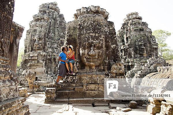 Couple visiting ancient temple  Angkor  Siem Reap  Cambodia