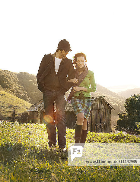 Couple walking in rural landscape