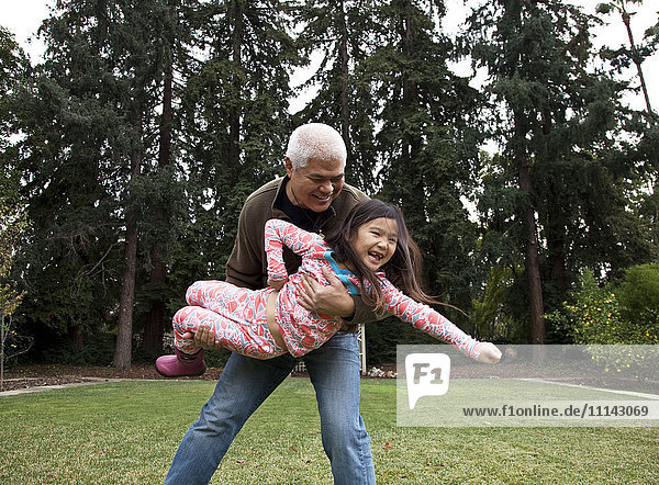 Father and daughter playing in backyard