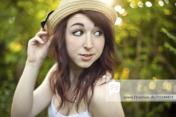 Caucasian woman wearing hat outdoors