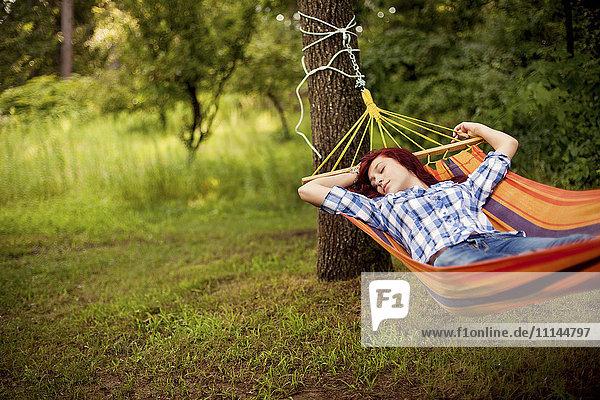 Sleeping girl laying in hammock