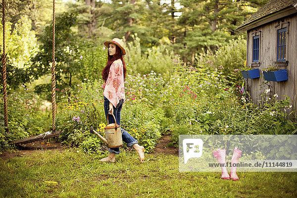 Gardener picking flowers in garden