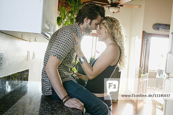 Couple hugging in kitchen Couple hugging in kitchen